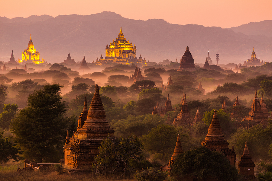 Pagoda landscape under a warm sunset in the plain of Bagan, Myan