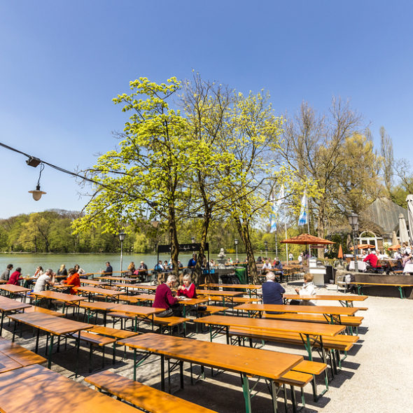 People Enjoy The Beautiful Weather At The   Seehaus In Munich